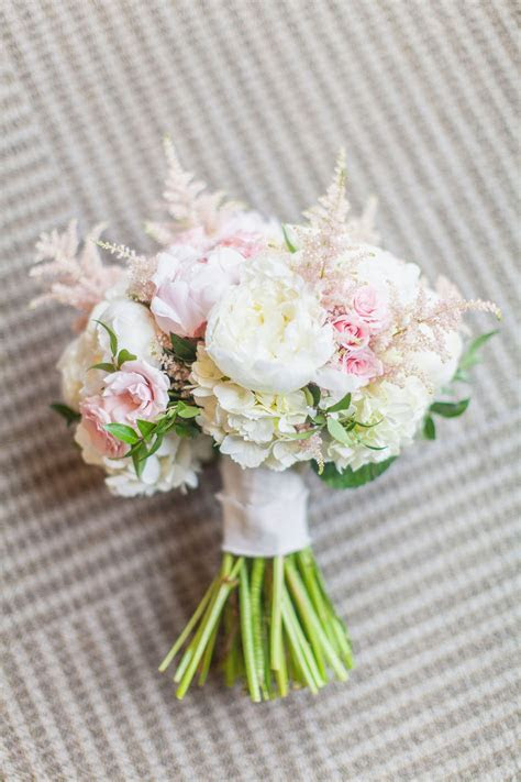 Blush and ivory bridal bouquet. White peonies, light pink