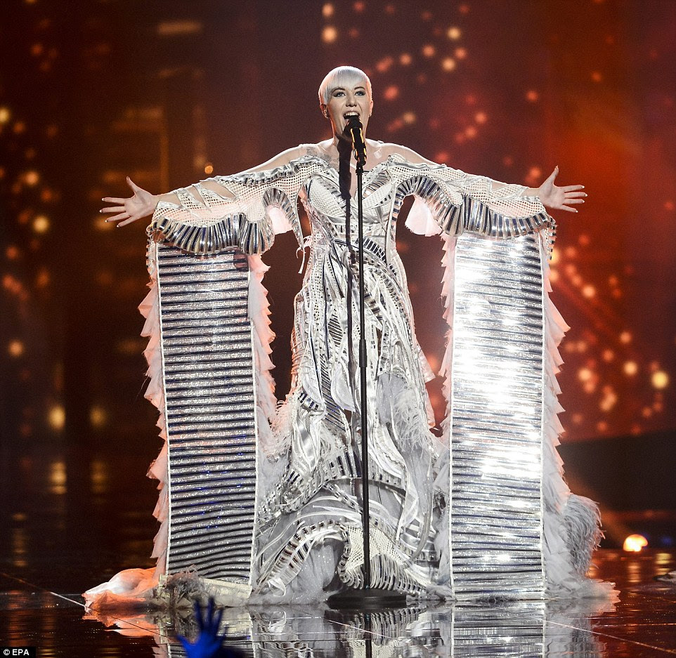 Nina Kraljic representing Croatia with the song Lighthouse performed in a dramatic white feathered  gown with metallic panels