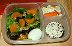 Hubby's lunch for work: Cucumbers and carrots, a mixed spring salad with raspberry vinegarette, mandrin oranges, raisins, walnuts and a hard boiled egg. For dessert he has a red velvet cupcake with cream cheese icing. Photo and lunch courtesy of Jen of Get Lucky  http://bit.ly/bd5s9A