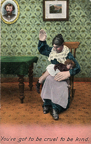 Woman spanking child