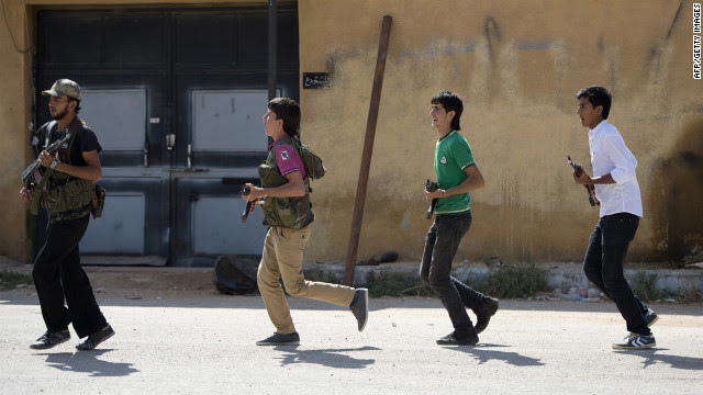 Brigade volunteers run as part of their training on the outskirts of Azaz, in northern Syria, on Wednesday.