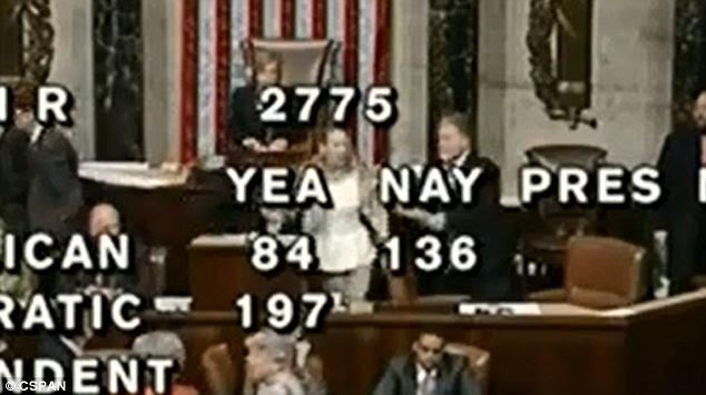 Escorted away: Dianne Reidy was forcibly removed from the House chamber after going on a rant about God and the Freemasons who designed the Constitution