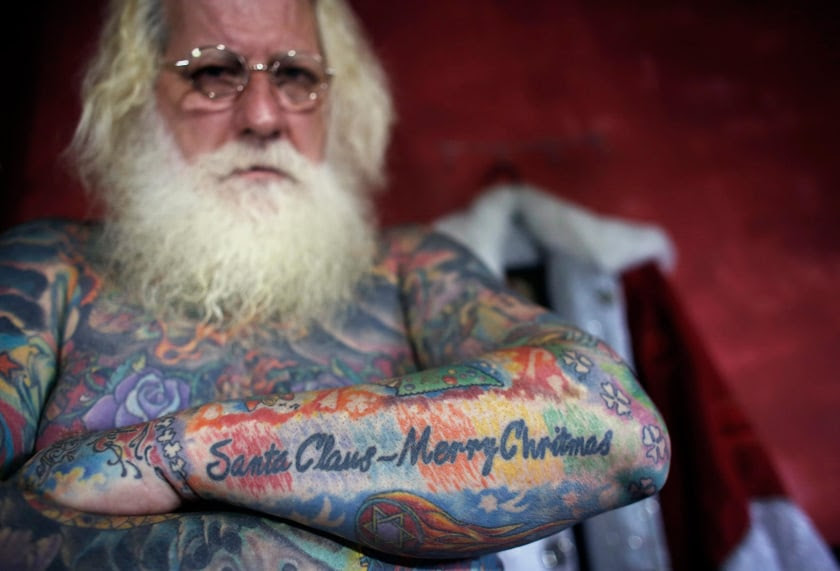 Image: Vitor Martins displays one of his Christmas tattoos inside his house near Sao Paulo
