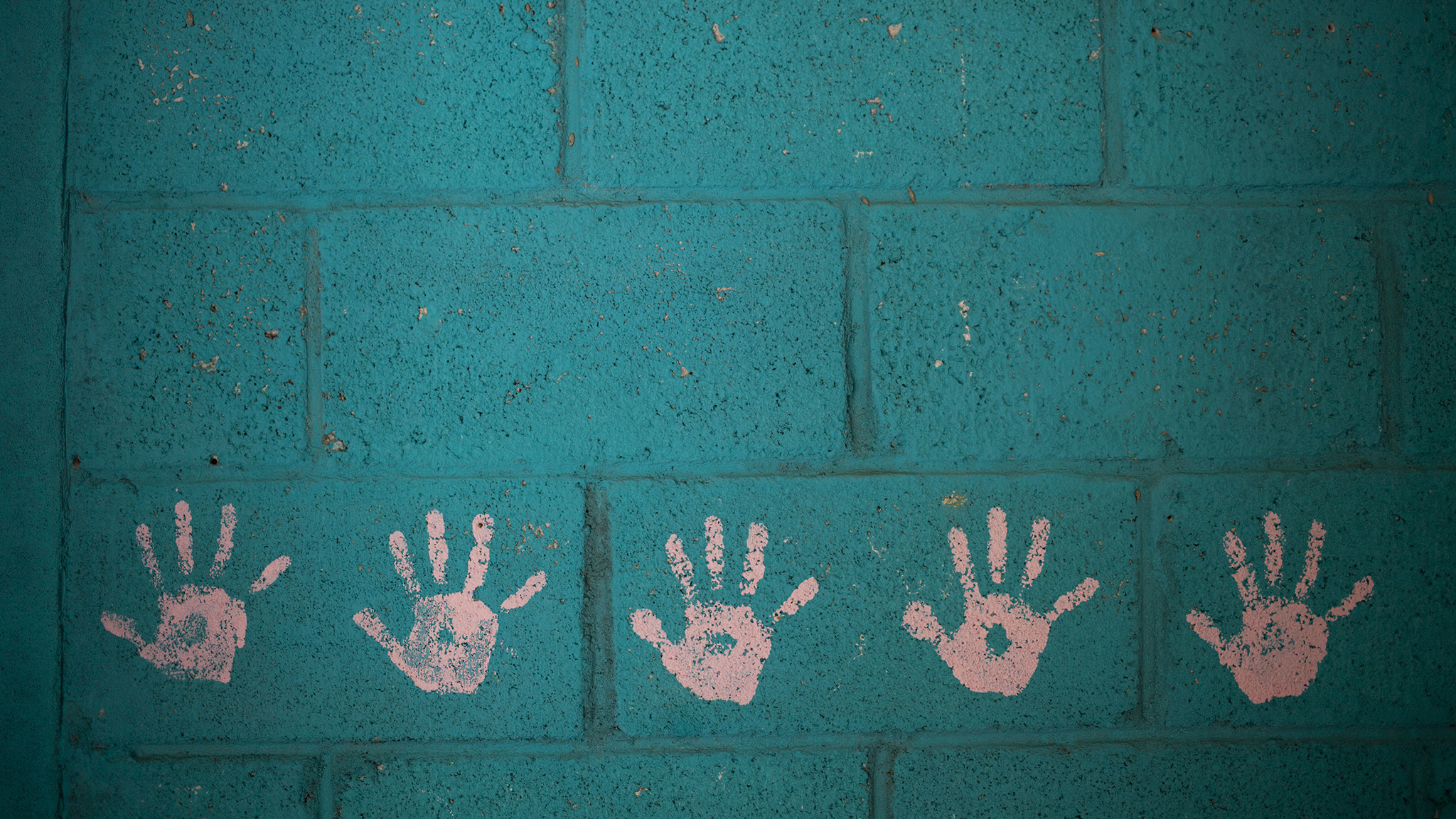 This Sept. 20, 2016 photo shows a child's room decorated with handprints inside an abandoned home in the neighborhood El Cambray in Santa Catarina Pinula on the outskirts of Guatemala City, one year after a mudslide destroyed the neighborhood.  The mandatory evacuation order was ignored by a half-dozen residents who apparently cannot afford to live anywhere else, and for the survivors, the psychological scares have not faded. (AP Photo/Moises Castillo)
