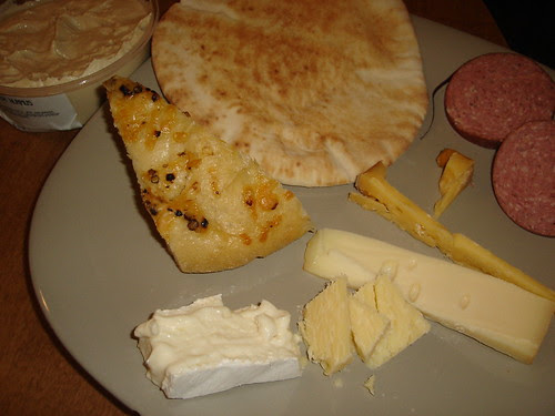 Bread, sausage, hummus, and 4 cheeses