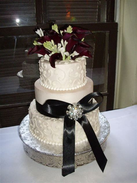buttercream wedding cake, three tiers, black ribbon