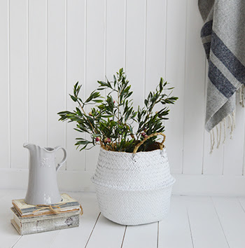 Add artificial greenery such as Eucalyptus, it complements the white interior so well and lives forever!