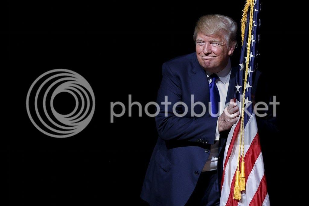 Trump hugging the flag