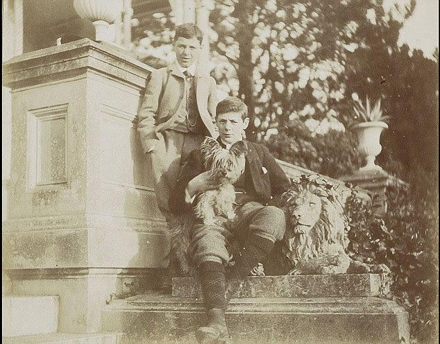With a Terrier on his lap, Winston poses with his brother Jack outside their Aunt Cornelia's home in Canford Magna near Bournemouth