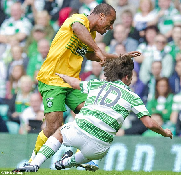 Falling in One Direction: Louis Tomlinson (right) is challenged by Gabriel Agbonlahor