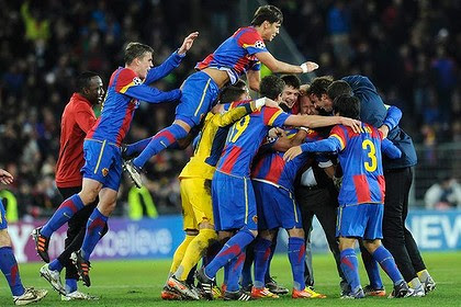 Joy ... Basel players celebrate after beating Manchester United.