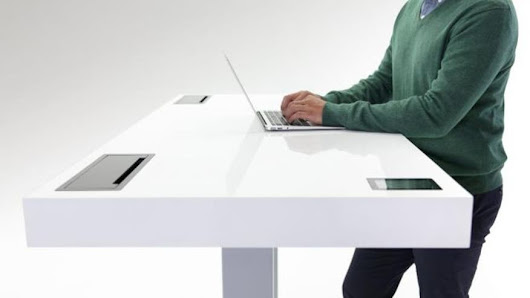 Modern standup desks coax office workers back on their feet