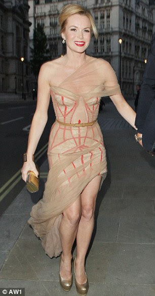 Cold shouldered: Amanda Holden at the Britain's Got Talent wrap party in a J'Aton Couture dress that is both sheer and a mullet (short at the front, long at the back). She needs a grown-up gown with more colour