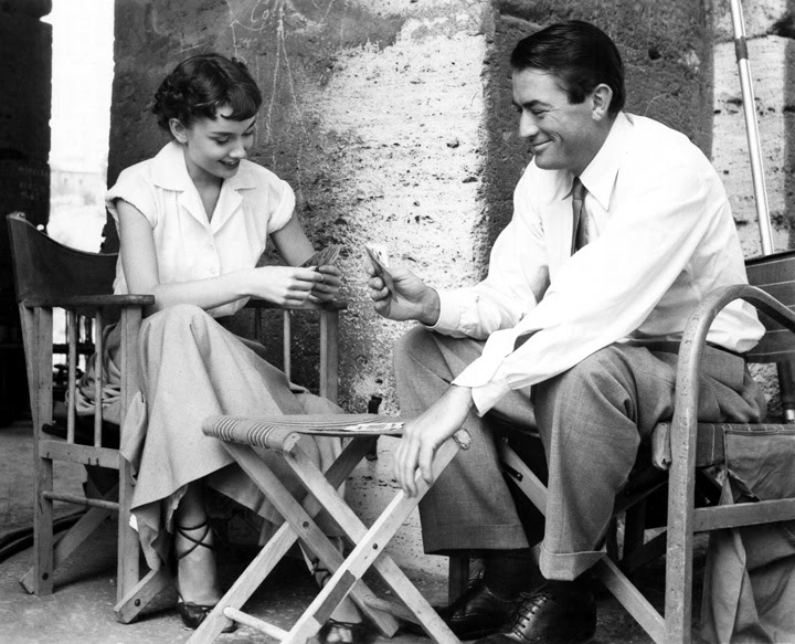 Hepburn and Peck playing cards between takes