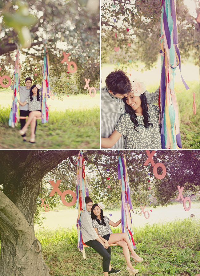 engagement photos on a swing with ribbons
