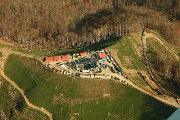 An aerial  photograph of a Stone Energy well pad and access road in West Virginia's Lewis Wetzel Wildlife Management Area.
