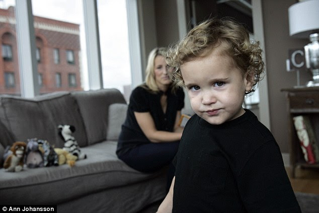 Cole Cameron Leinart, (then 2), with mother Brynn Cameron, takes a closer look at the camera at their home in Los Angeles, March 9, 2009