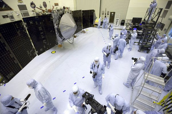 Reporters and photographers gather in front of NASA's MAVEN spacecraft as it was put on display for the media to see at the Kennedy Space Center in Florida, on September 27, 2013.