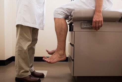 Photo of man on exam table, about to be screened for prostate cancer.