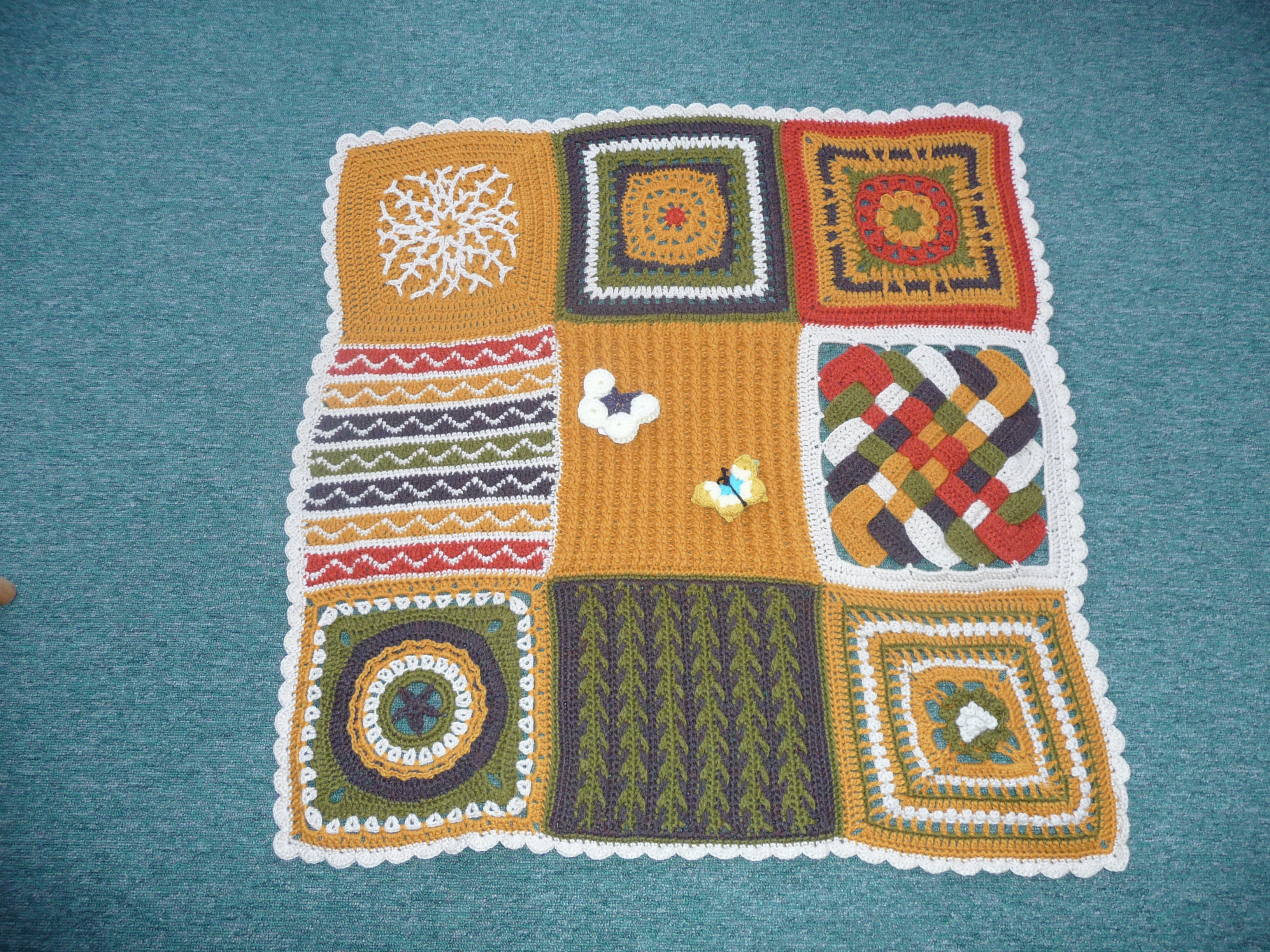 Squares from the Chain Reaction Afghan which is free from Interweave Crochet.