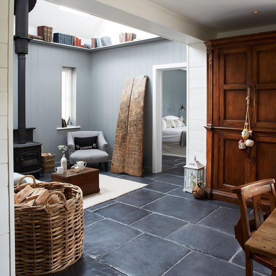 Rustic living room with wood burner and slate floor | West Sussex country house | House tour | PHOTO GALLERY | Country Homes and Interiors | Housetohome.co.uk