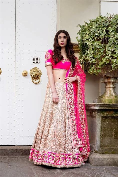 Manish Malhotra gold and pink lehenga with a sequined