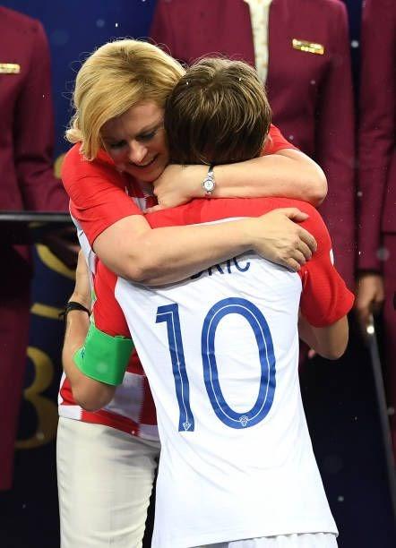 Luka Modric of Croatia embraces Kolinda GrabarKitarovic President of Croatia following the 2018 FIFA...