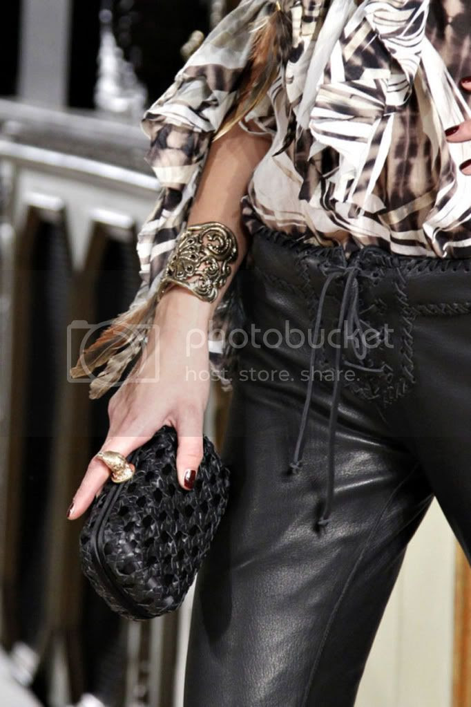 clutch,leather pants,frills