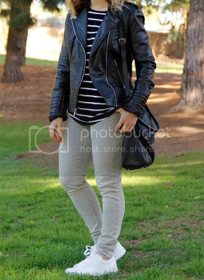 LA fashion and personal style blogger The Key To Chic wears a striped a.n.a. top, Michael Michael Kors leather moto jacket, grey J Brand skinny jeans, Kate Spade Cobble Hill Little Minka bag, and Adidas Superstar 2 sneakers