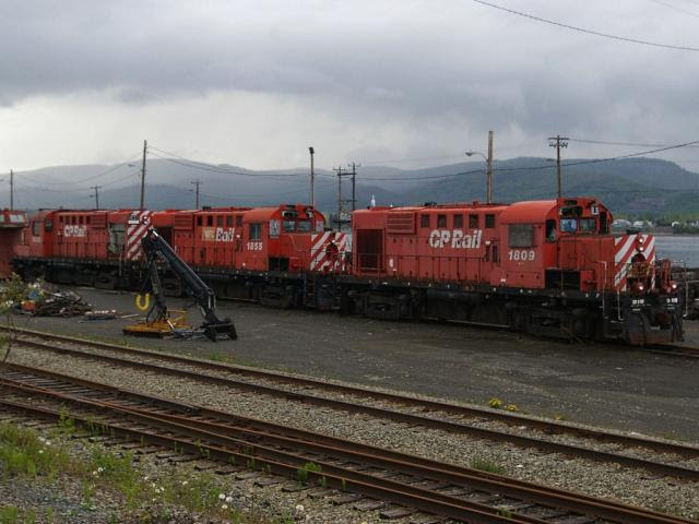 NBEC 1809, 1855, 1830 at Campbellton waiting for the scrapper