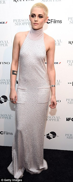 Gorgeous style: The actress opted to wear a floor-length silver gown with a high neckline that sat close around her neck and was completely open at the back