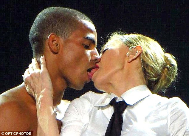 Raunchy: Madonna puckered up to her toyboy lover, Brahim Zaibat, on stage in Brazil