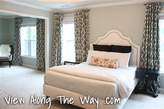 Bedroom with Upholstered Bed and Navy Damask Curtains/Drapery Panels