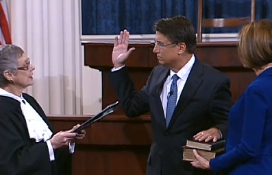 Justice Sarah Parker swears in Pat McCrory as his wife, Ann, looks on in Raliegh, NC