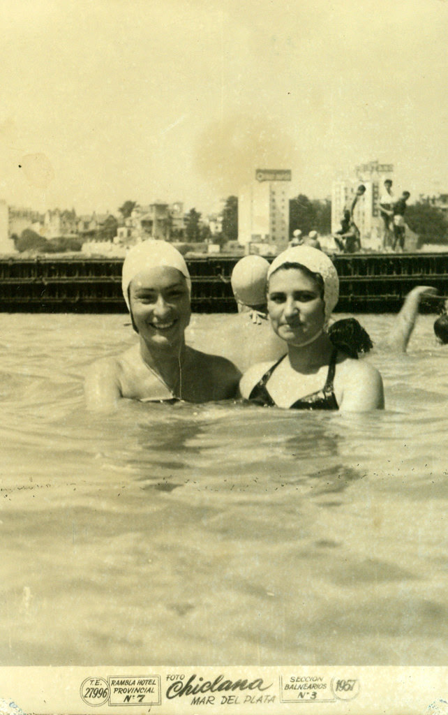 By the sea - Two women with caps