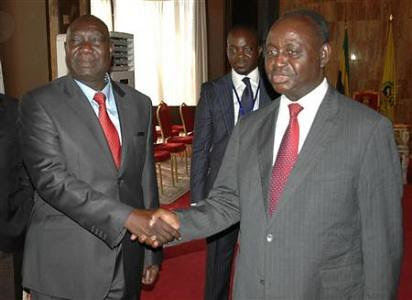 Michel Am-Nondokro Djotodia (L), leader of Central African Republic's (CAR) Seleka rebel alliance, shakes hands with CAR's President Francois Bozize (R) during peace talks with delegations representing the government and the opposition rebels in Gabon. by Pan-African News Wire File Photos