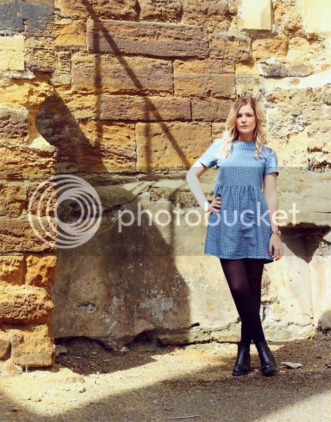 girl wearing check smock dress boohoo