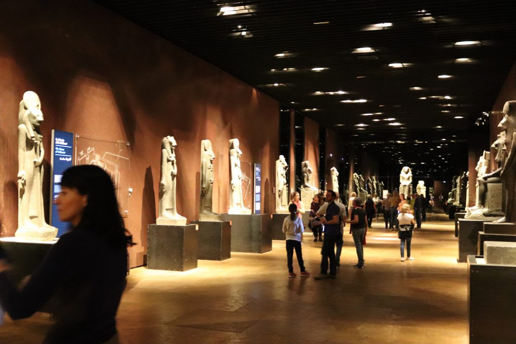 View of the second room of the Hall of Kings, including a            colossal seated statue of Thutmose III (c. 1450 BC) and            fifteen Sekhmet statues from the reign of Amenhotep III (ca.            1,390 BCE)