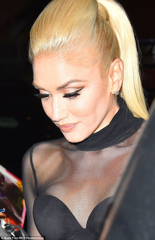 Blonde beauty: The singer's flawlessly applied face included lashings of mascara on her long lashes as well as smokey eyelids and a slick of black adding extra decoration