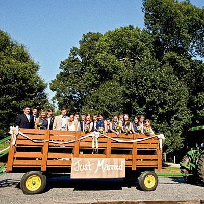 "Tractor Sign | A tractor with a ""Just Married"" sign transports this wedding party around the property for pictures. 