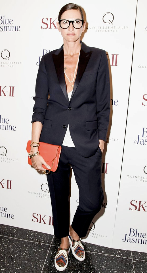 LE FASHION BLOG MODERN SUIT JENNA LYONS TUX TUXEDO SUIT SATIN LAPEL CROPPED CROP PANTS HAIR BUN BLACK FRAME EYEGLASSES RED LIPS LIPSTICK ORANGE CLUTCH BAG PRINT SLIP ON GIVENCHY SNEAKERS 2 photo LEFASHIONBLOGMODERNSUITJENNALYONSGIVENCHYSNEAKERS2.png