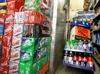 Antonio Garcia re-stocks the beverages at The Corner Market in Washington, D.C., in 2010.