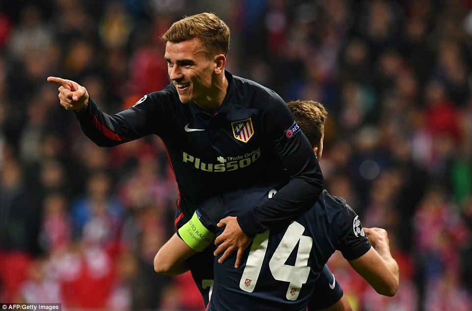 Antoine Griezmann points towards Fernando Torres after his assist, which saw Atletico Madrid equalise at the Allianz Arena