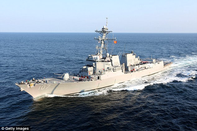 The USS Mahan (pictured in 2012) has been forced to change course and fire warning flares by an Iranian attack boat that raced towards it with its weapons manned