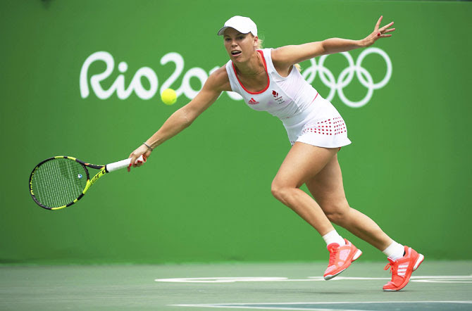 Denmark's Caroline Wozniacki in action against Czech Republic's Petra Kvitova during her women's singles first round match at the Rio Olympics on Monday