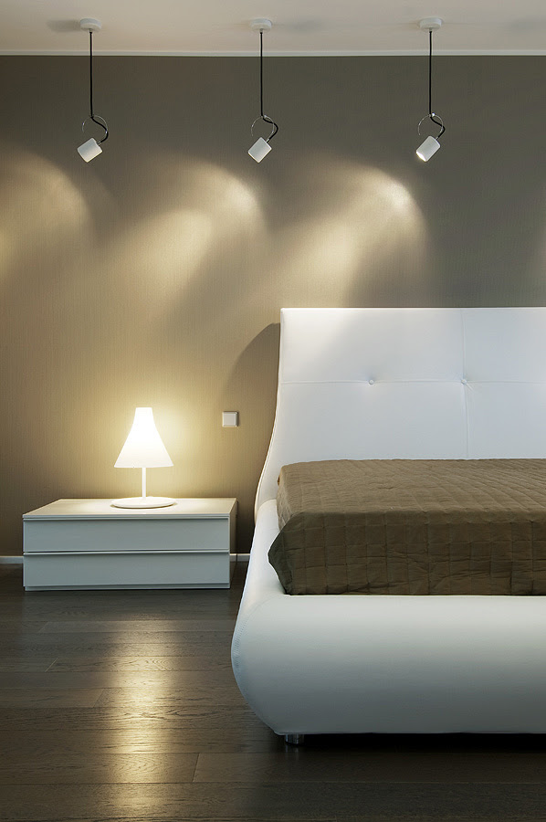 bedroom cool palette with warm accents self illuminating lamp and wood flooring