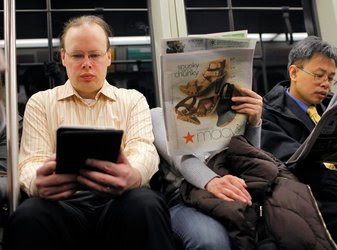 A Kindle reader on a train in Cambridge, Mass. E-book best-seller lists are full of genre novels.