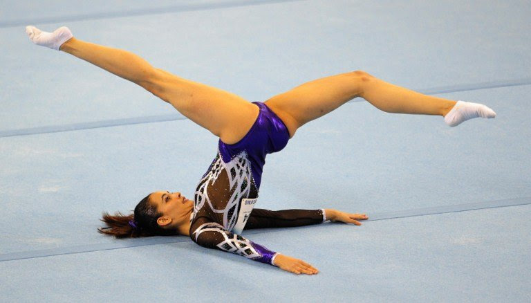 Farah Ann Abdul Hadi of Malaysia competes during the women's floor excercise routine final at the 28th Southeast Asian Games (SEA Games) in Singapore on June 10, 2015. AFP PHOTO