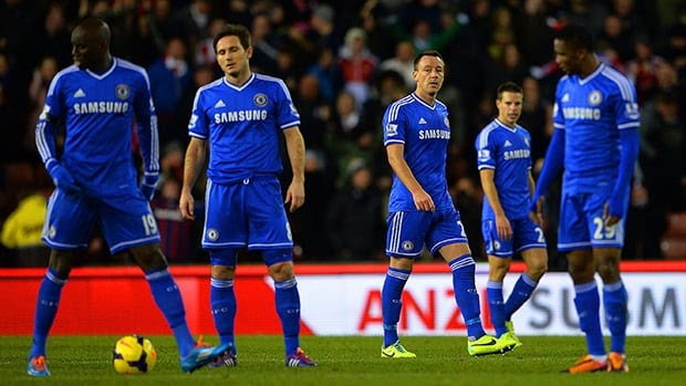 Dejected Chelsea players look on after conceding a third goal to Stoke City at Britannia Stadium on December 7, 2013 in Stoke, England.
