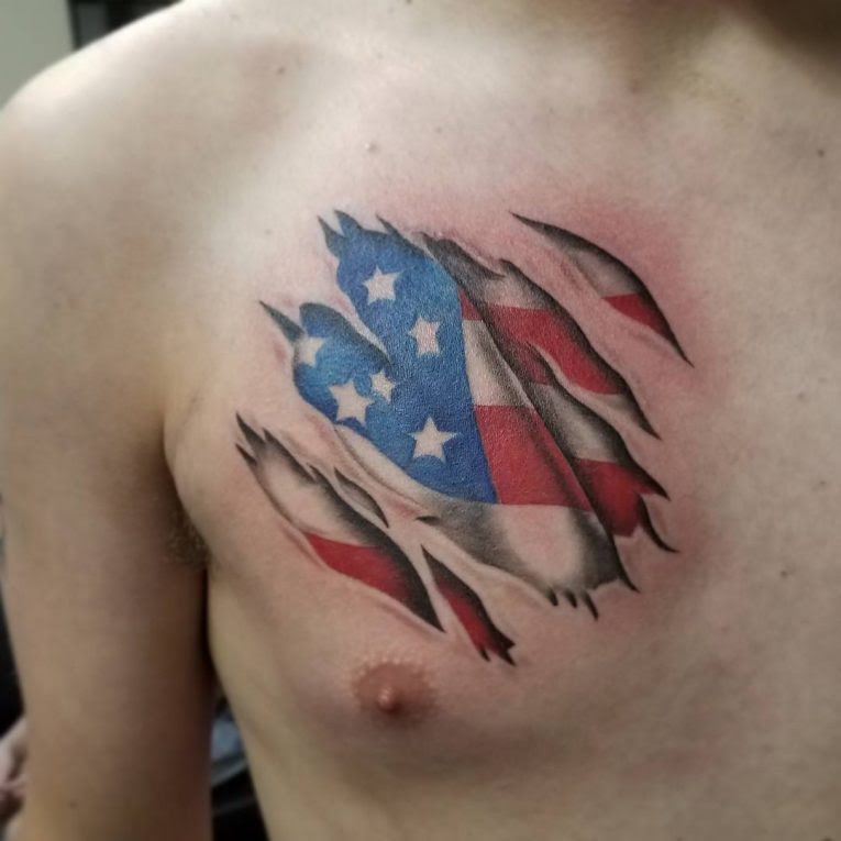 Stunning N Ripped Skin American Flag Tattoo Idea On Man Chest